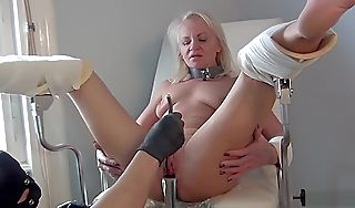 Female jingling on gyno easy chair