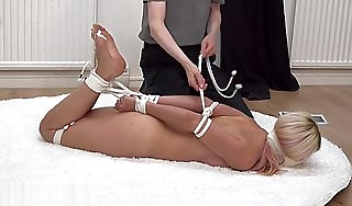 beautiful german blonde tape gagged and hogtied